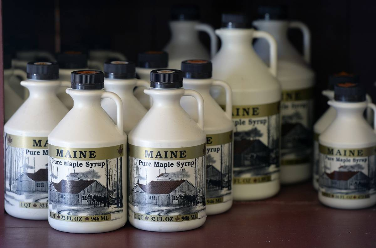Containers of Maine Maple Syrup are seen on a grocery store shelf.