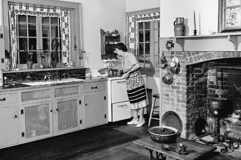 A woman works in her kitchen in her Virginia house, 1947.