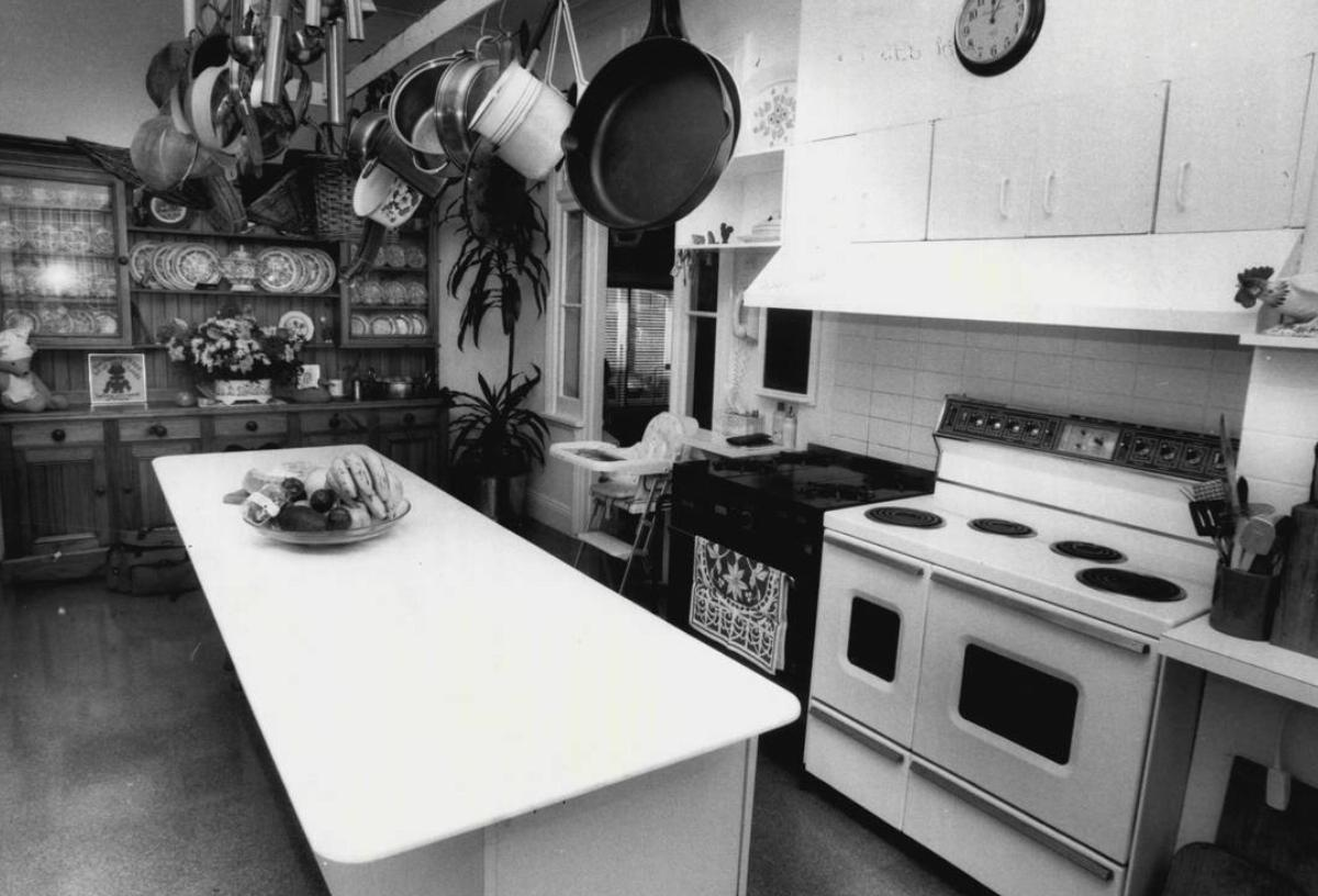A large, long kitchen island is seen in this 1987 kitchen.