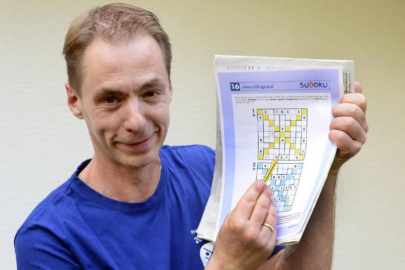 A sudoku master shows off his puzzles.