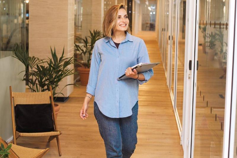 a woman walking in an office