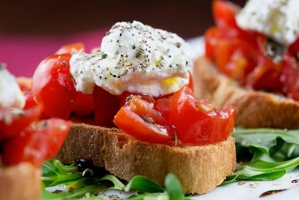 Bruschetta with tomato, basil, oregano, ricotta, and extra virgin olive oil
