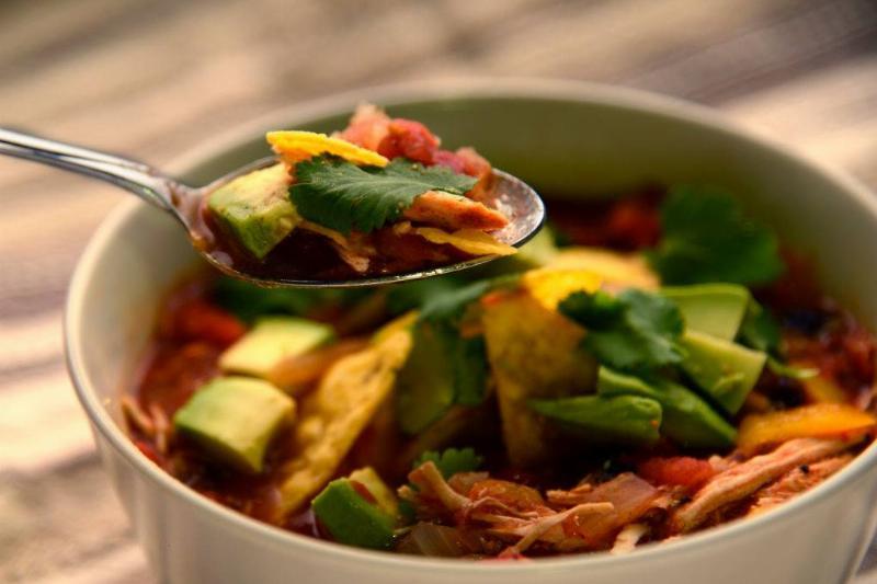 chicken tortilla soup with avocado, cilantro, and salsa fresca