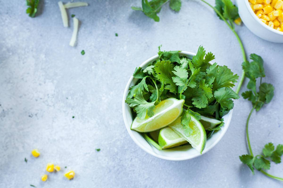 a bowl with cilantro and limes