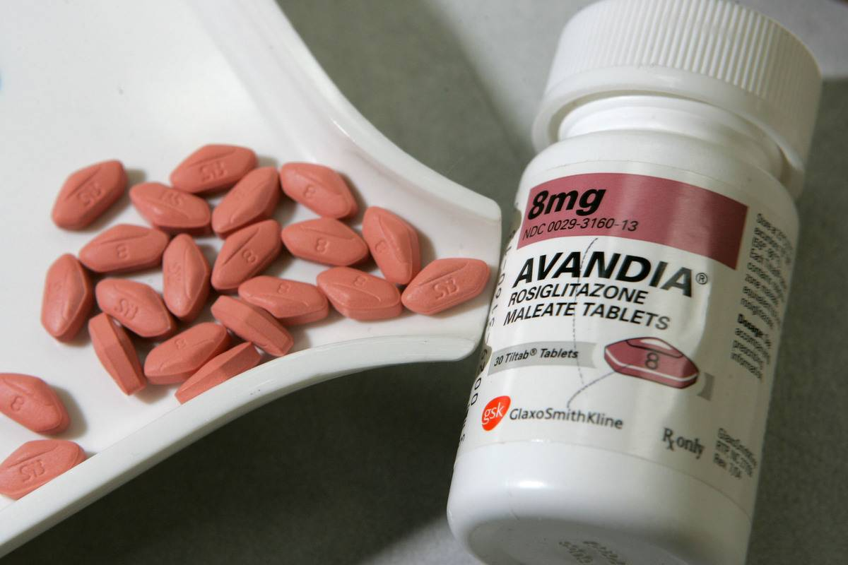 Diabetes pills sit next to their jar.