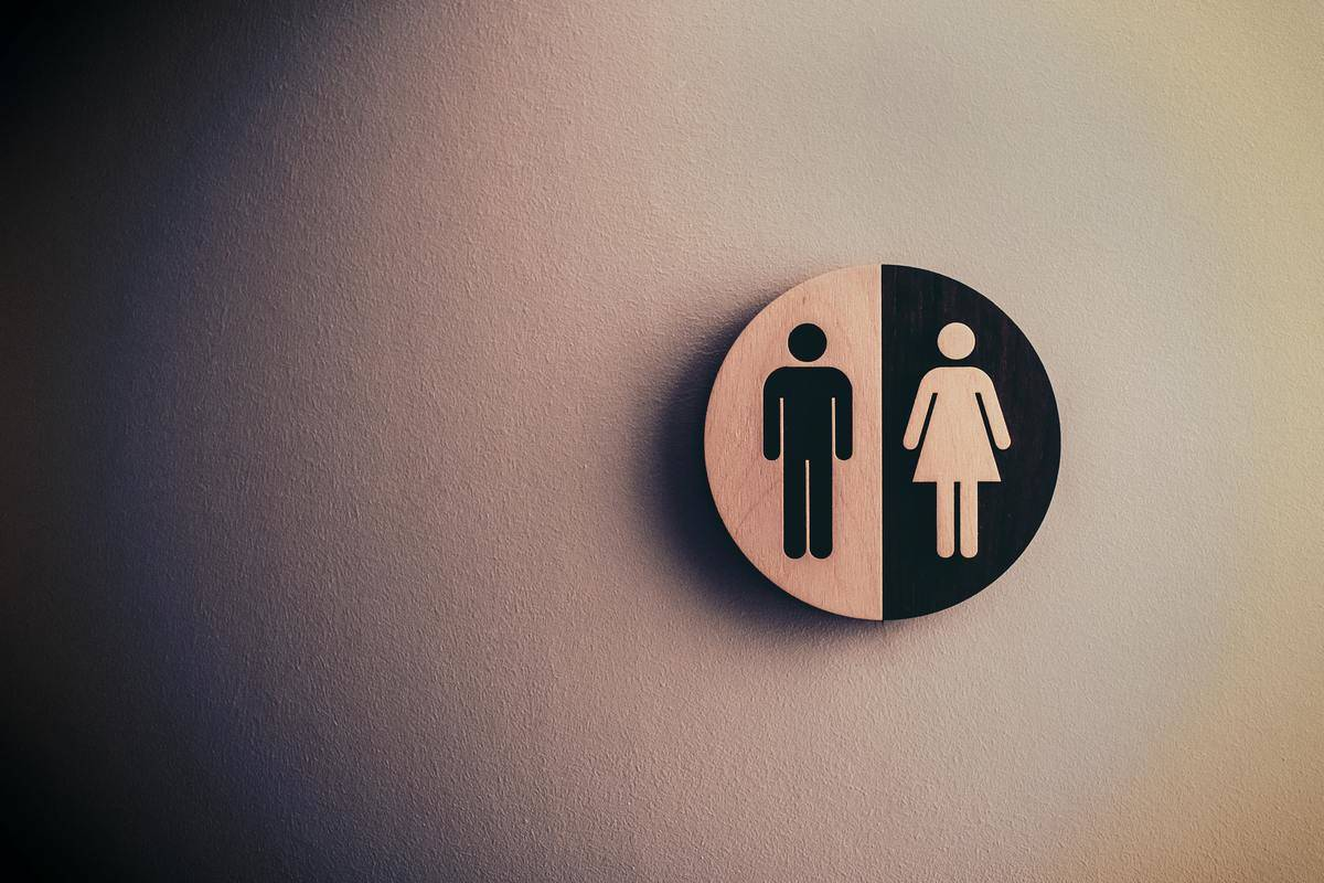 a sign with figures of a male and female
