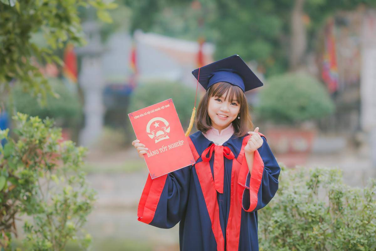 a girl with a graduation robe and cap