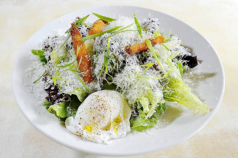 local greens salad with green goddess dressing, fried anchovies, fresh grated parmesan and a poached egg
