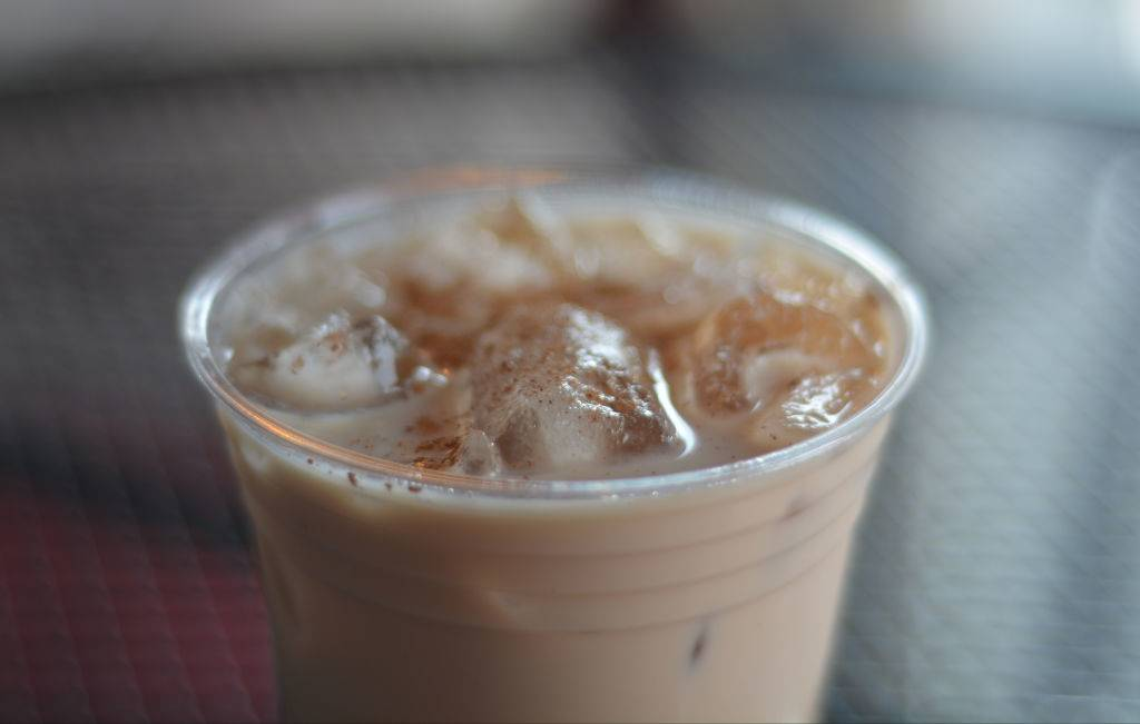iced chai latte in a clear cup