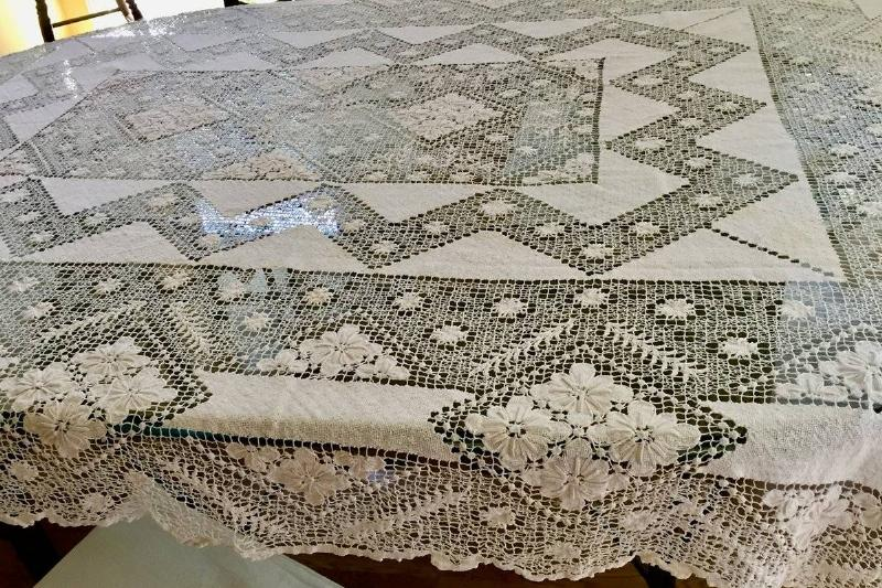 ivory-lace-tablecloth-on-a-black-table-28783
