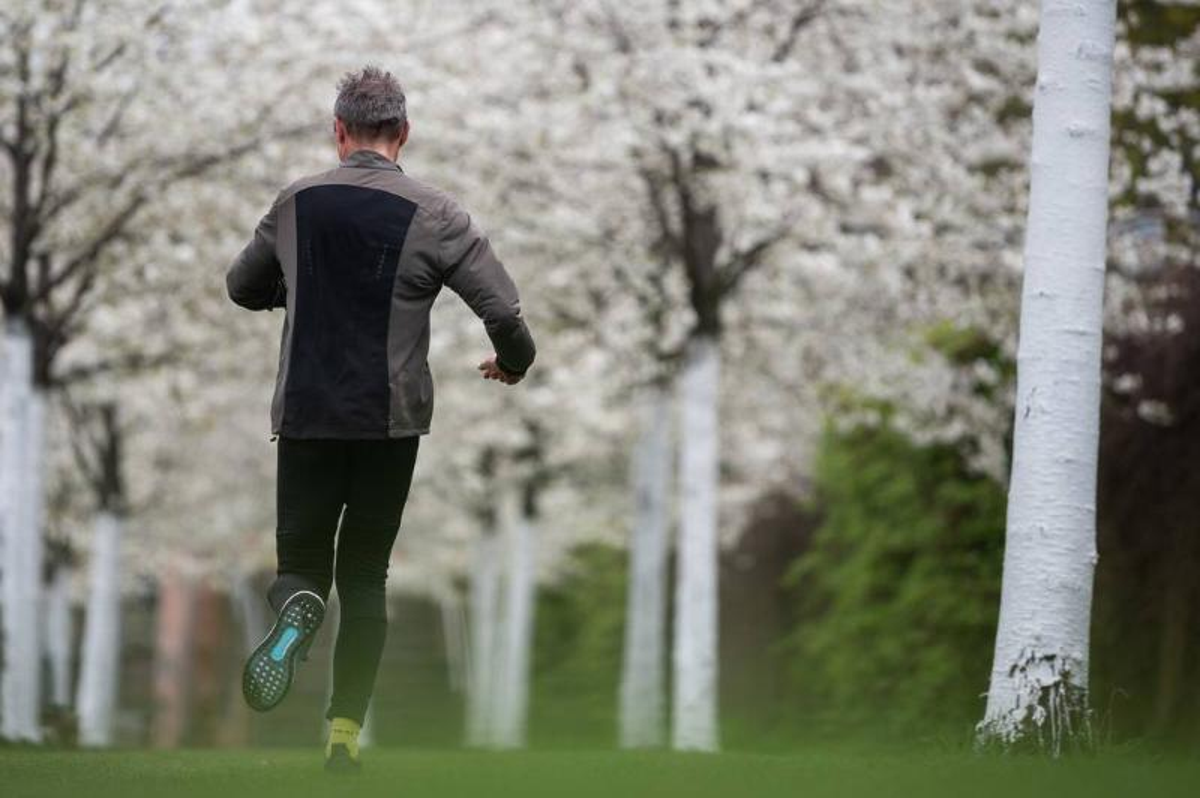 A man jogs outside.