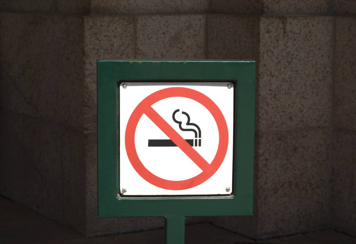 A no smoking sign is seen.