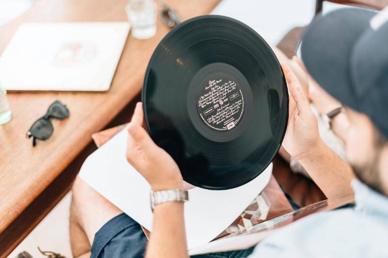 a man holding a vinyl record