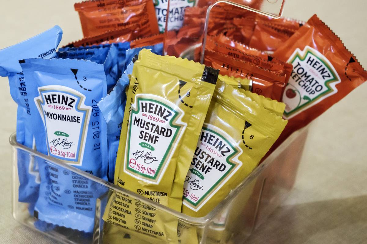 Bags of condiments are offered at a restaurant.