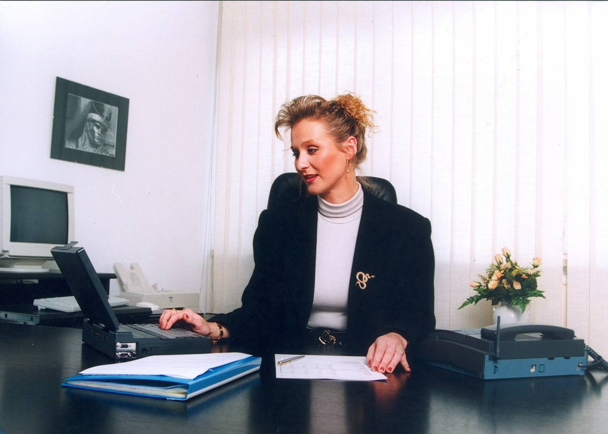 A woman works at her desk in her office.
