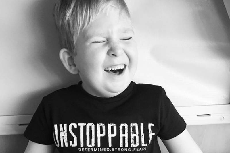 noah in a black and white photo with an unstoppable t-shirt