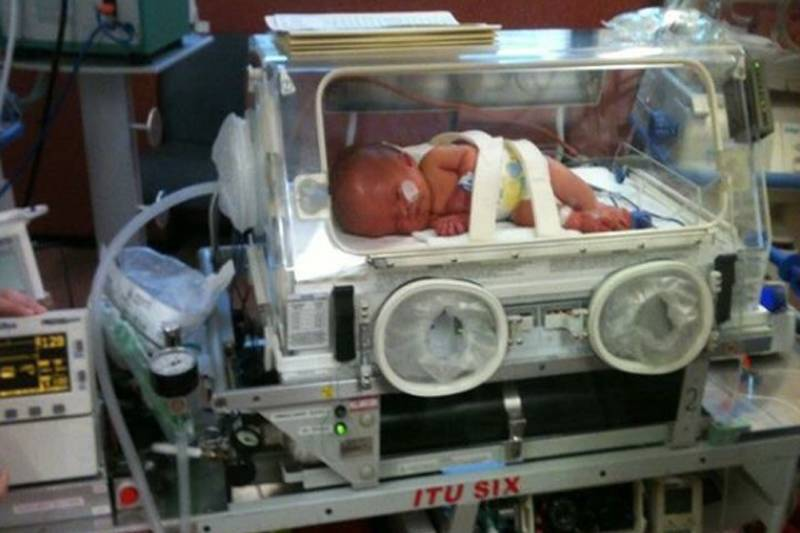 noah in an incubator after being born