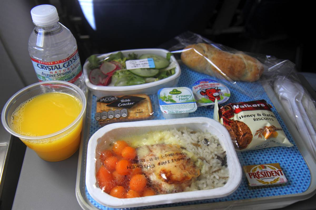 Packages of processed foods are served on a plane.