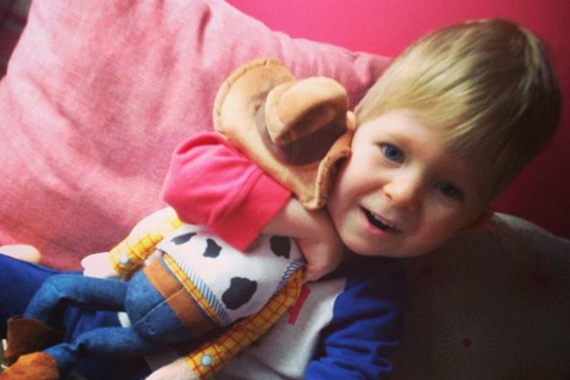 noah as a toddler with a doll