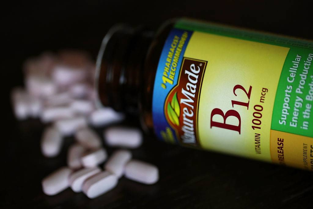 A bottle of vitamins B12 pills is displayed