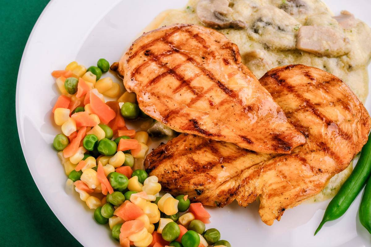 chicken breast with peas, corn, carrots, green beans, and mushrooms