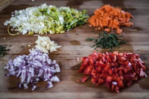 chopped onions, tomatoes, garlic, herbs, and carrots