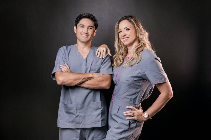 male and female doctors smiling for a photo