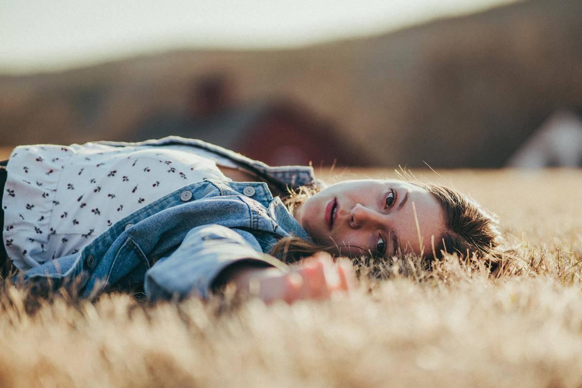 a woman lying down in a field