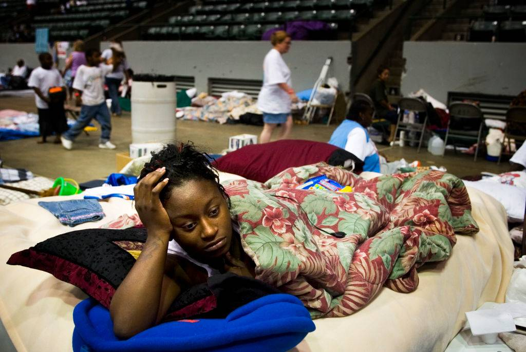 a woman lying down in a gym in Jackson, Mississippi