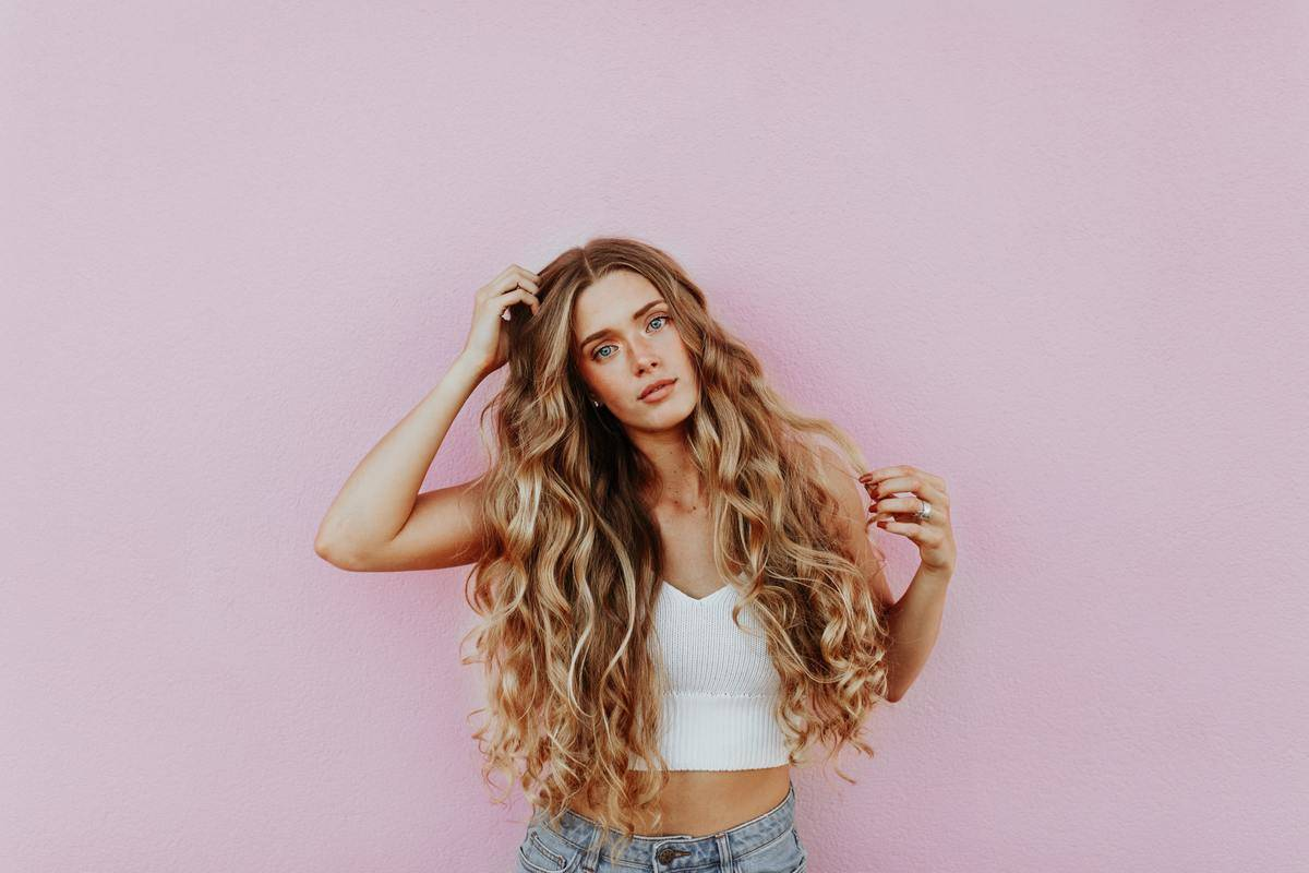 photo of young woman with long blonde hair